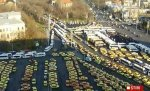 Transport workers turn Bucharest into car park