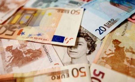 Cea de-a cincea tranşă din împrumutul de la FMI ar putea ajunge azi în România