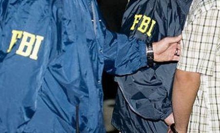 SUA: 24 de români, arestaţi de FBI pentru fraude fiscale