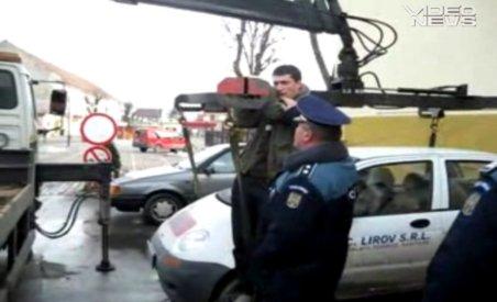 Scandal la Codlea: Un bărbat a reuşit să împiedice ridicarea unei maşini