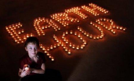 Mii de români au stins lumina, milioane au făcut-o pe glob pentru Earth Hour 2011