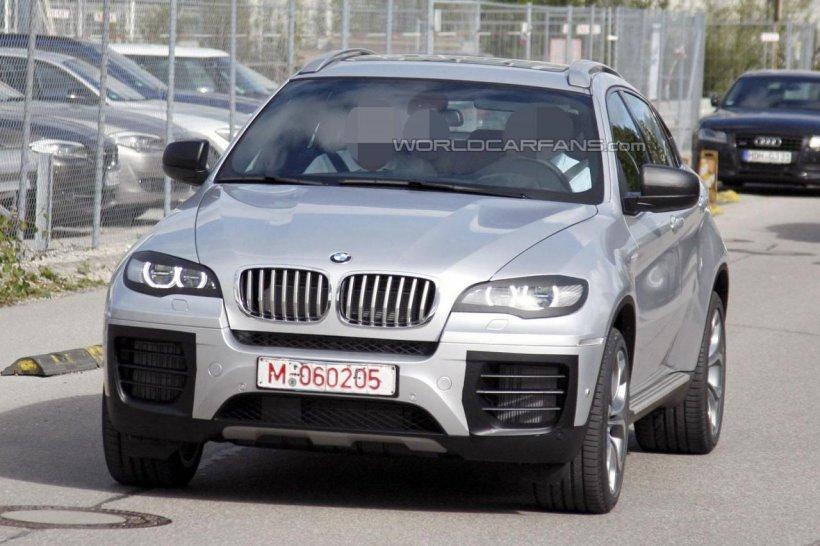 BMW X6 cu facelift, surprins în imagini spion aproape fără camuflaj