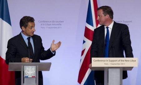 Sarkozy şi Cameron au promis că NATO va ajuta Libia până când Gaddafi nu va mai fi un pericol