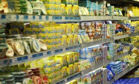 Românii trăiesc de pe o zi pe alta, dar marile magazine fac profituri considerabile