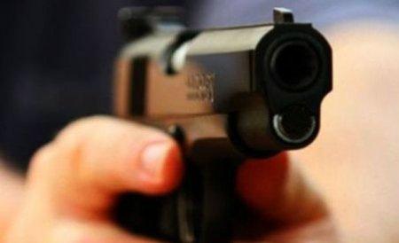 Focuri de armă în Capitală: Poliţia a prins doi suspecţi de furt din locuinţe