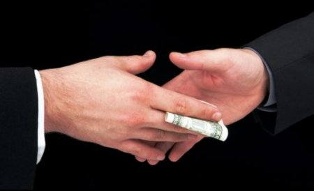 Avocat de la Baroul Bucureşti, reţinut de DNA pentru că a cerut şpagă 20.000 de euro