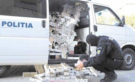 Percheziţii la Timiş, Hunedoara şi Alba. Poliţia caută persoane care fac contrabandă cu ţigări