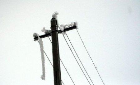 Aproape 140 de localităţi din Ilfov şi Giurgiu au rămas fără energie electrică din cauza ninsorii şi a viscolului