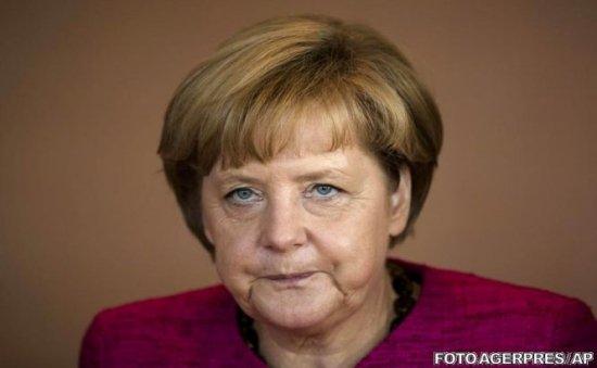 Merkel nu este de acord cu adoptarea copiilor în famili de homosexuali