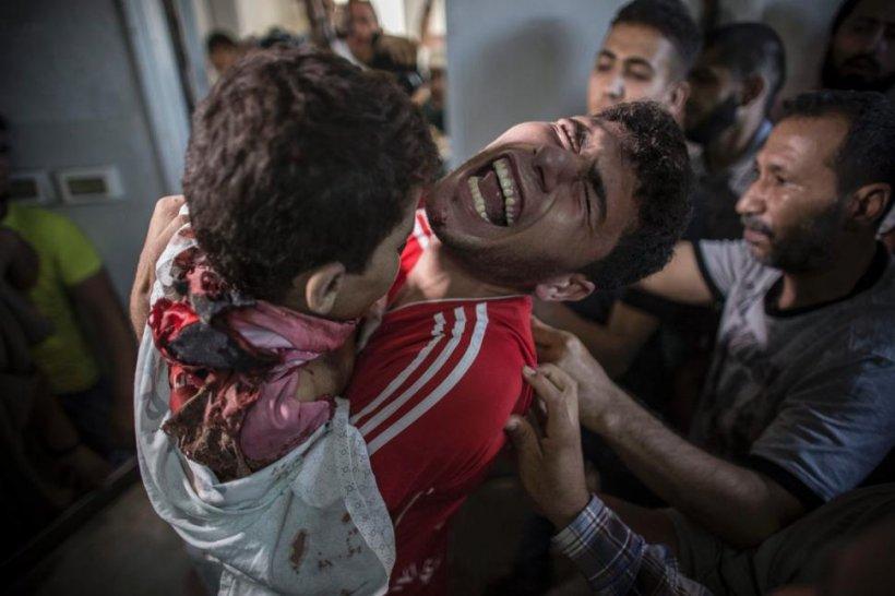 E îngrozitor ce s-a întâmplat ieri în Ţara Sfântă. Patru copii, OMORÂŢI de un obuz israelian chiar pe plajă