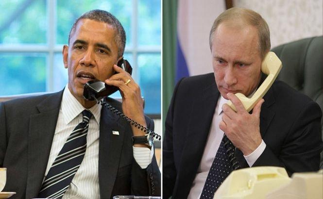 Presa germană: Obama l-a AMENINŢAT pe Putin înainte de întâlnirea de la Minsk