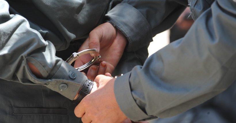 Doi români şi un italian, acuzaţi de terorism