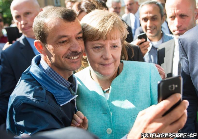 După ce au fost primiți cu îmbrățișări, partidul lui Merkel ia în calcul izolarea refugiaților