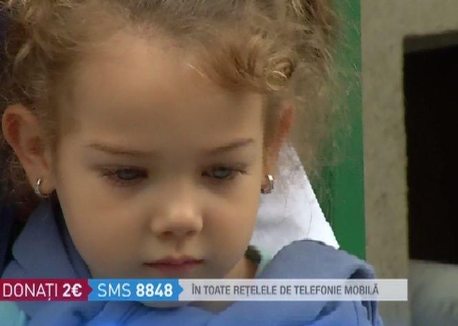 Eva, o fetiță de patru ani, este bolnavă de cancer la ambii rinichi. Un sms la 8848 îi poate salva viața