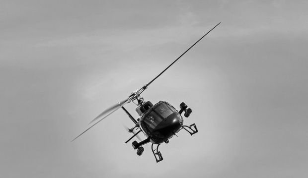 Elicopter prăbușit în urmă cu puțin timp. Pilotul a murit pe loc