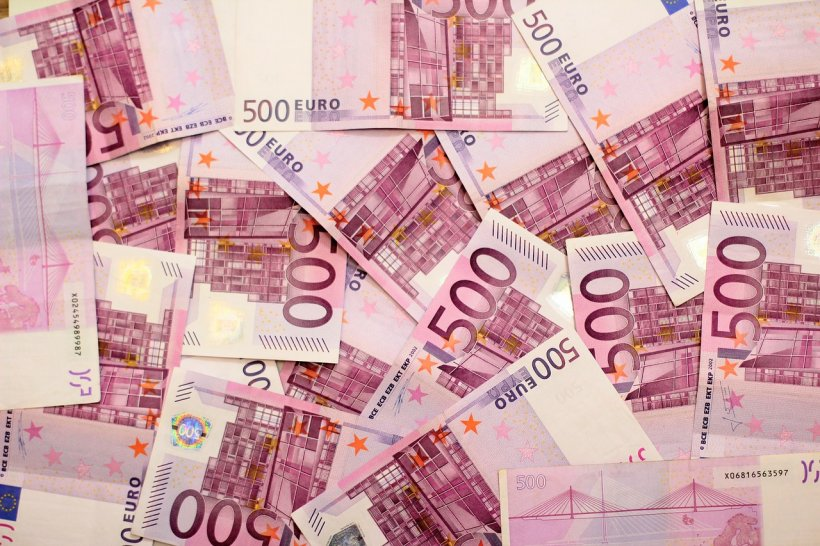 How many romanians work abroad and how much money they sent in the country