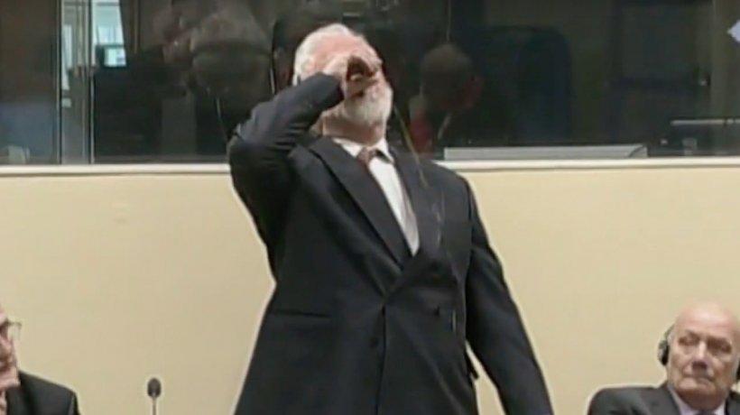 Un criminal de război a murit după ce s-a otrăvit în sala de tribunal - VIDEO