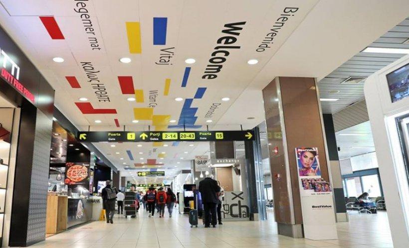 """Aeroportul Otopeni: Mesajul """"Bine ați venit"""" tradus în mai multe limbi, dar pus pe tavanul din zona """"Plecări"""""""