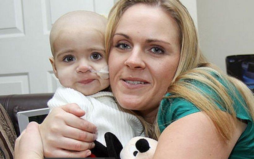 Și-a ținut fiica în brațe în timp ce se stingea din cauza cancerului, dar la câțiva ani de la această tragedie s-a întâmplat ceva înfiorător