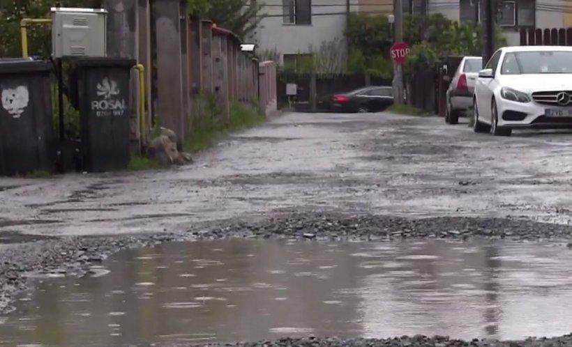 Străzi de coșmar în cartiere de lux din România - VIDEO