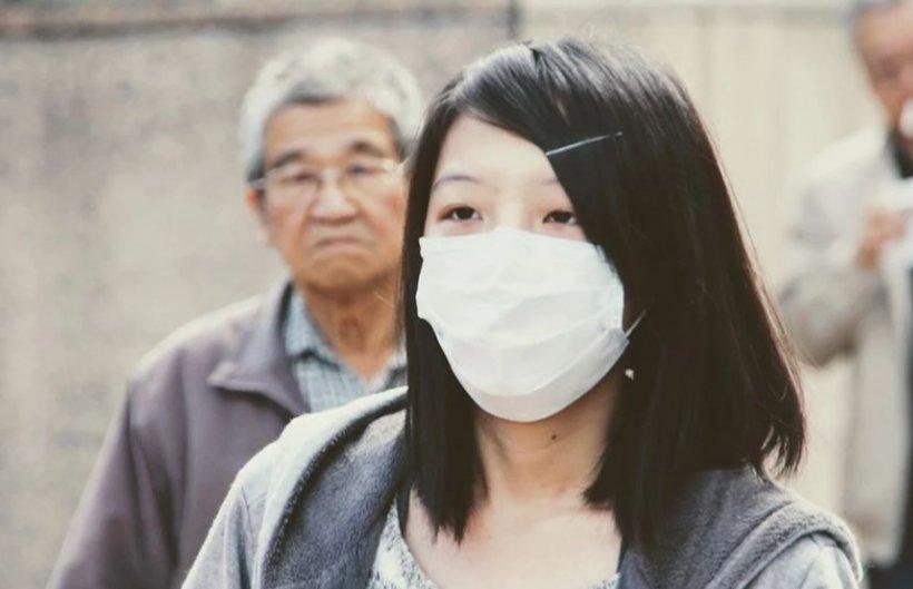 Trei oraşe din China au fost închise, din cauza noului virus gripal