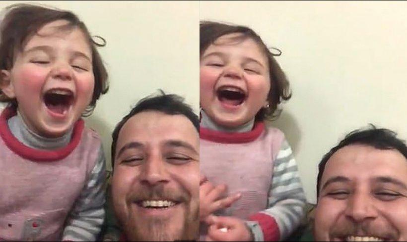 Un tată din Siria își învață fetița să râdă atunci când cad bombe (Video)