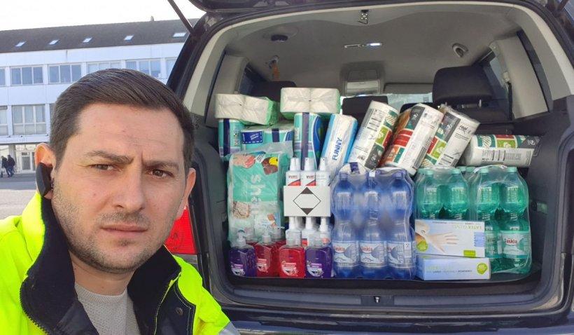 Un român din Germania a cumpărat apă, săpun, dezinfectant și mănuși pentru șoferii de TIR din parcări