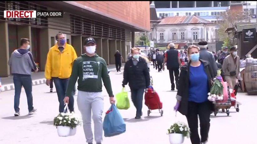 Românii, de neoprit în goana după cumpărături. Pieţele riscă să devină focare din infecţie