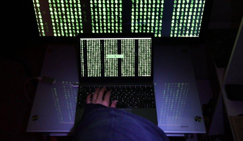 Hackeri din România și Moldova, săltați de DIICOT după ce au atacat site-uri oficiale