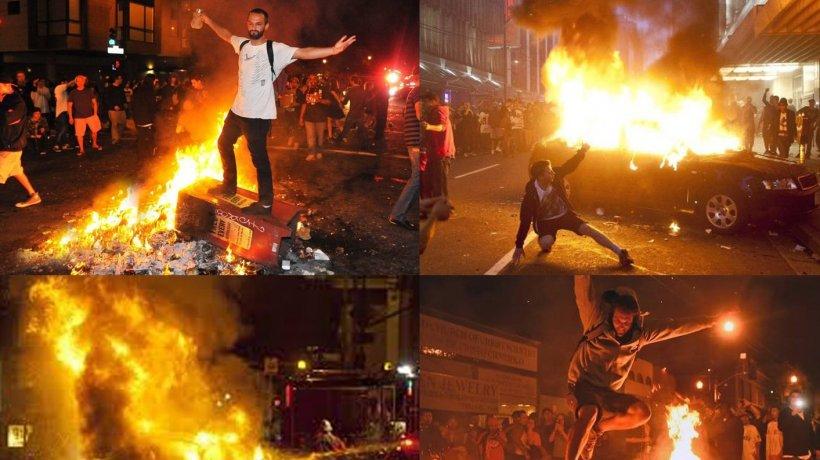 Proteste violente în Statele Unite. O secție de poliție a fost incendiată, iar jafurile au ajuns la ordinea zilei