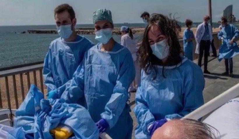Bolnavii de COVID din Spania, duși de medici să vadă marea