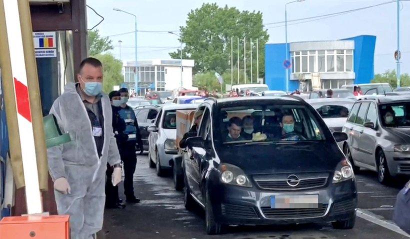 Muncitori români angajați la un abator din Germania, fugiți din carantină și prinși la graniță în România