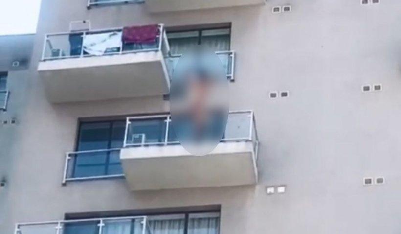 Tânăr dezbrăcat filmat când se aruncă de la etajul 6 al unui bloc din București