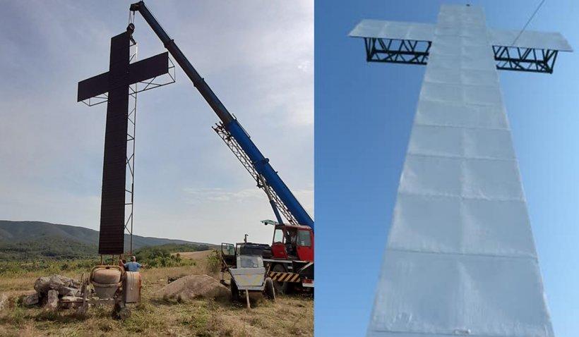 Un preot din Satu Mare a ridicat în sat o cruce uriaşă, înaltă cât un bloc cu patru etaje. Se vede de la câţiva kilometri depărtare