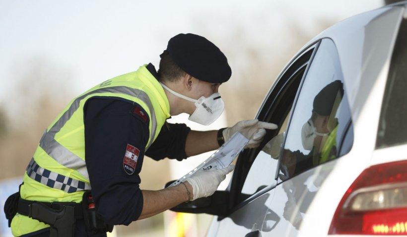 Zidar român prins în Austria cu permisul și buletinul vecinului său cu care seamănă