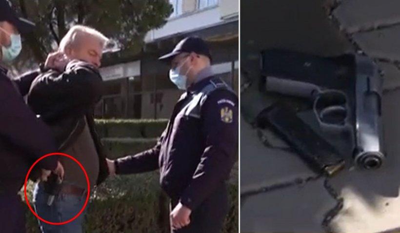 Bărbat înarmat prins în direct la TV cu un pistol, pe o strada din Oneşti