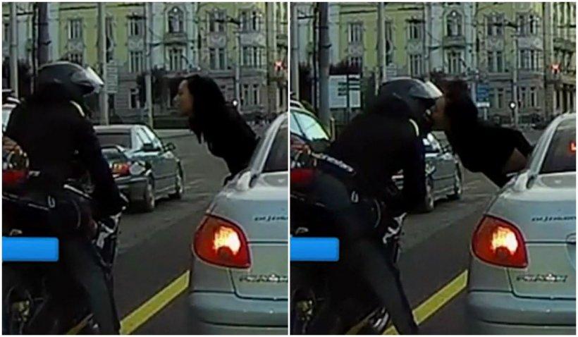 Un motociclist și o șoferiță, sărut romantic în timp ce așteptau la un semafor din Cluj