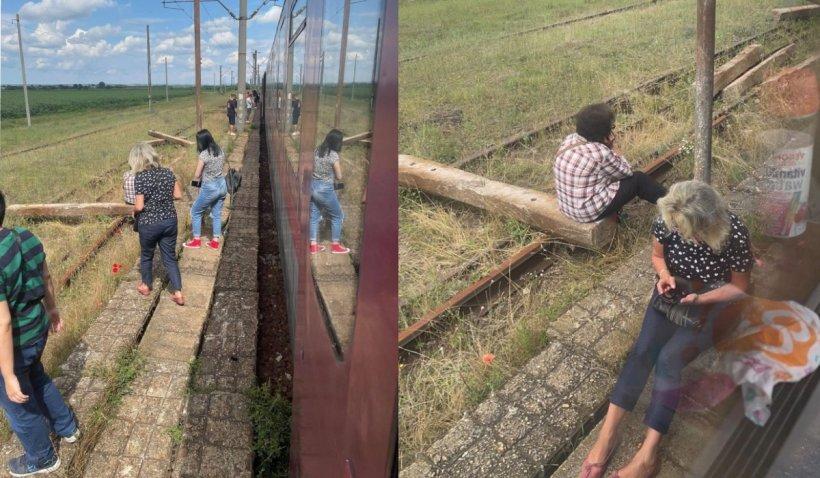 O locomotivă CFR Călători s-a defectat pe traseu: Oamenii au fost lăsați să aștepte fără apă, pe caniculă, în câmp