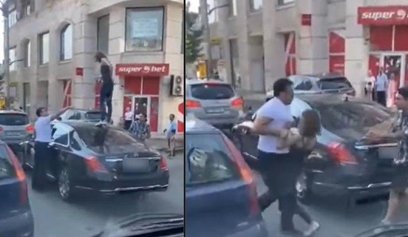O femeie s-a urcat pe o masină de lux oprită la semafor în Bucureşti şi a început să danseze