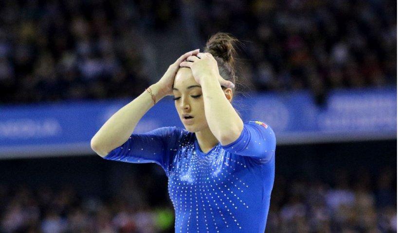 Larisa Iordache accidentată în calificările pentru finala la bârnă, rămâne în concurs