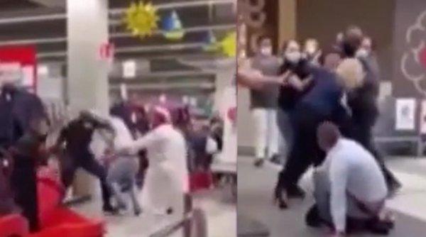 Doi români s-au luat la bătaie cu agenţii de pază dintr-un magazin din Italia pentru că nu purtau măşti de protecţie