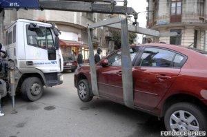 Ridicarea maşinilor parcate neregulamentar, ilegală